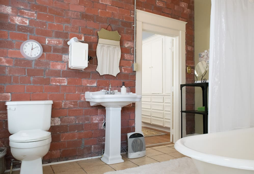 exposed brick in the roomy bath with Italian marble floors - small heater to heat before your shower if needed