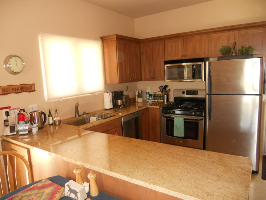 Granite Counter Tops, Stainless Appliances, Coffee, Tea, Spices, and the Comforts of Home...