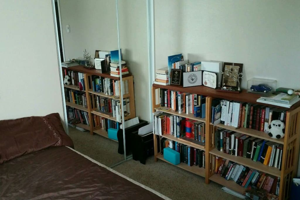 Help yourself to James' large collection of books! ... okay some are mine too.