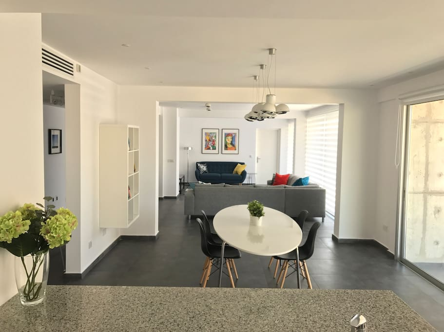 Dining and Living Spaces as seen from the Kitchen