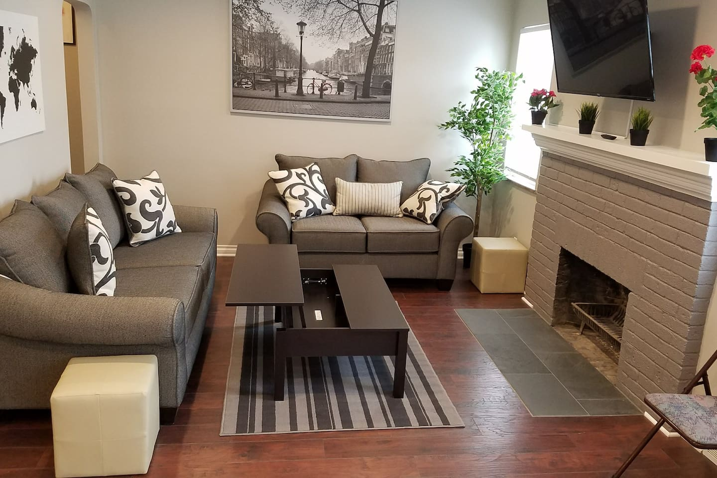 Comfortable living room with a trick coffee table for your laptop or a meal.