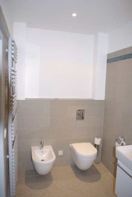 The bathroom has a waterfall shower, bidet, toilet and sink. Molton Brown toiletries and white cotton towels that are changed every day or on request as you prefer.