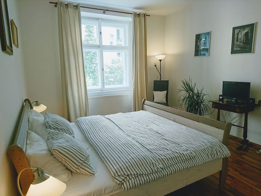 Bedroom with comfy king size bed and a windows to quiet inner courtyard.