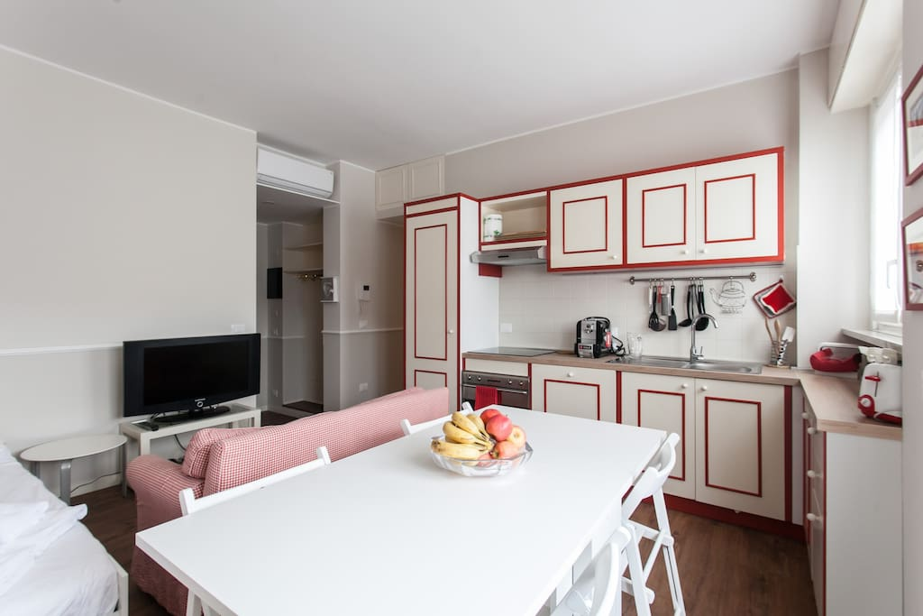 Living area: double bed & sofa, TV - equipped kitchen & dining table x4