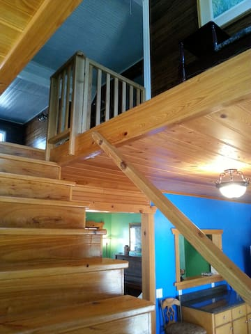 Cypress staircase leading to bedrooms.