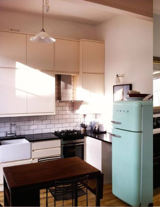 Open plan kitchen. Lovely fridge and fully stocked kitchen for your use!