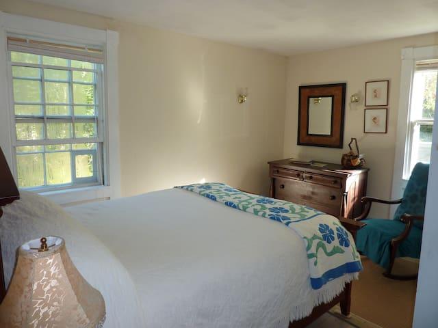 Main floor queen bedroom on north side of house.