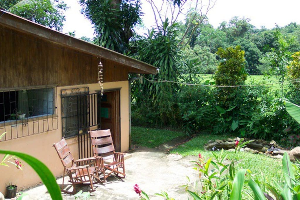 A warm welcomes awaits you here. Rio Naranjo is across the pasture, beyond the trees.