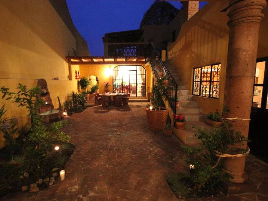 An inviting courtyard awaits you for an al fresco dinner, while you listen to the pleasing sound of the fountain. The Casita windows and entrance door is visible at right.