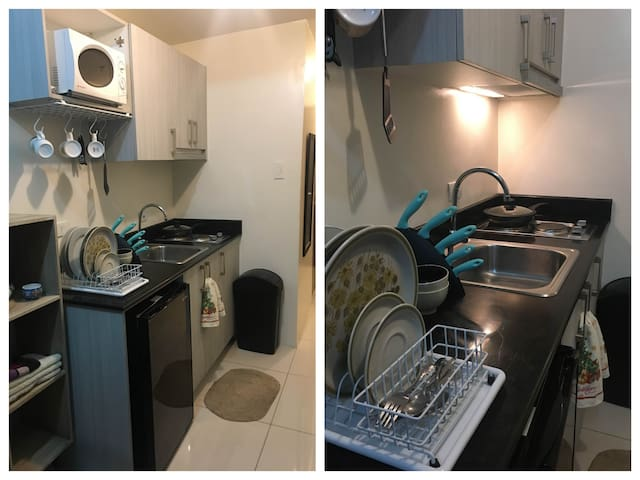 Kitchen with complete utensils, refrigerator, microwave oven, rice cooker