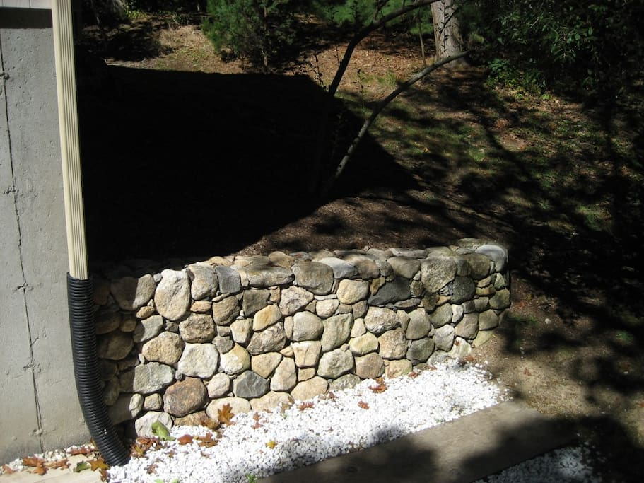 Custom stone wall built by local mason