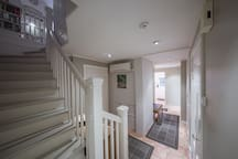 Hallway from ground-floor (entrance, bedrooms, utility room and bathrooms). Stairway up to kitchen & living rooms.