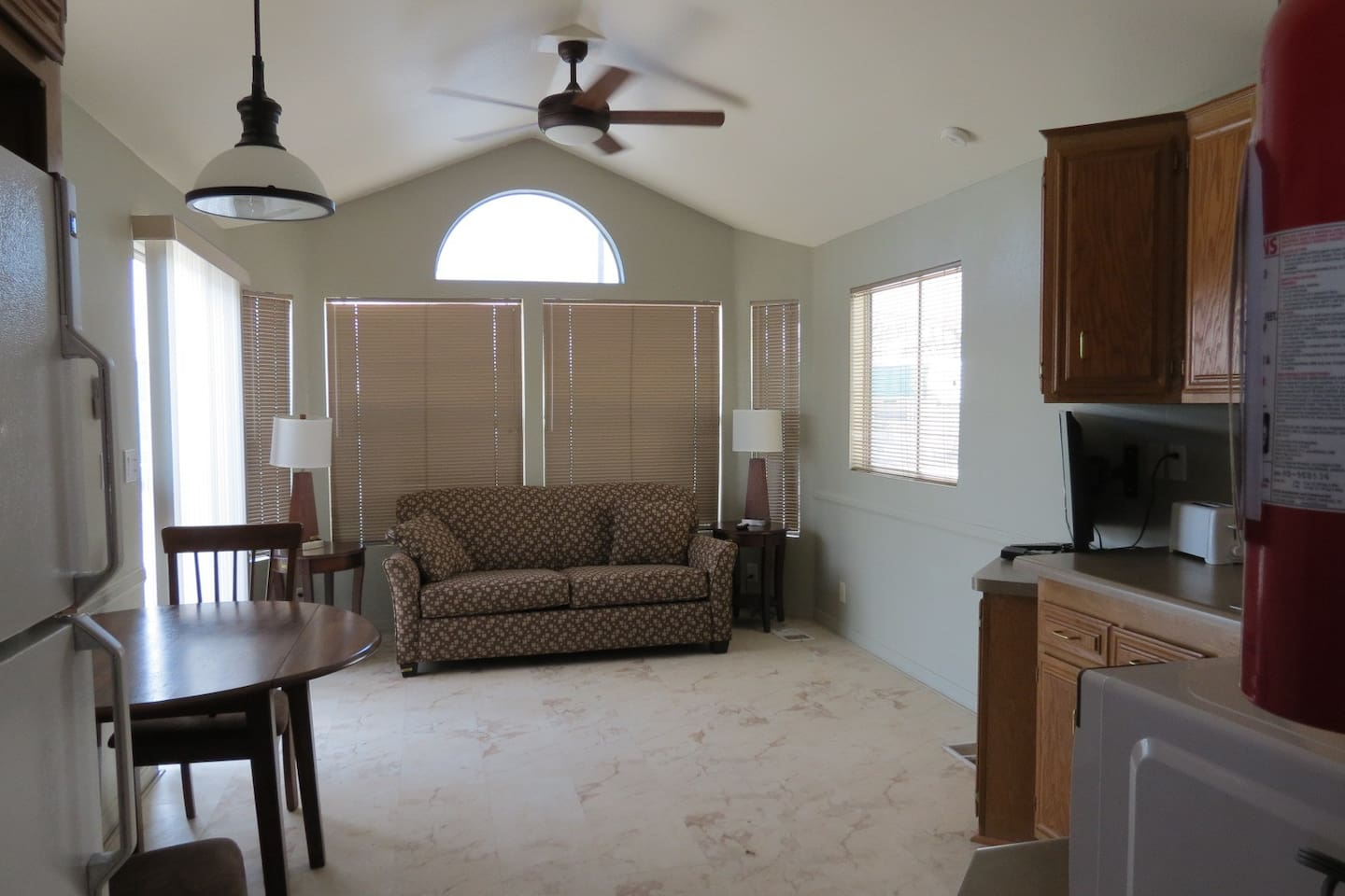 Open living area with convertible couch