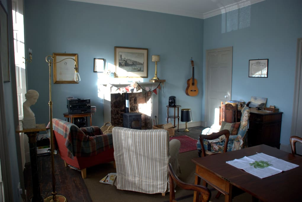 The reception room is flooded with afternoon light. Shared.
