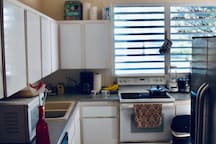 Kitchen all furnished: stove with oven,  refrigerator, dishwasher, microwave, ceiling fan, washer, dryer, detergent, coffee maker, blender, cups, dishes, silverware, cabinets