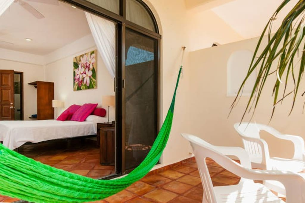 Breezy terrace with a hammock.