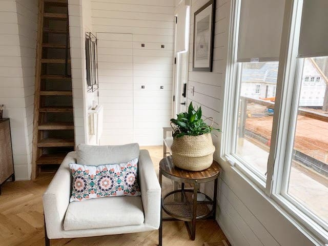 Our foyer, which shows the hidden door to the bathroom and also shows the staircase up to the loft level. NOTE: The staircase to the loft is narrow; however, there is a study steel handrail and latched gate at the top to provide safety and security!
