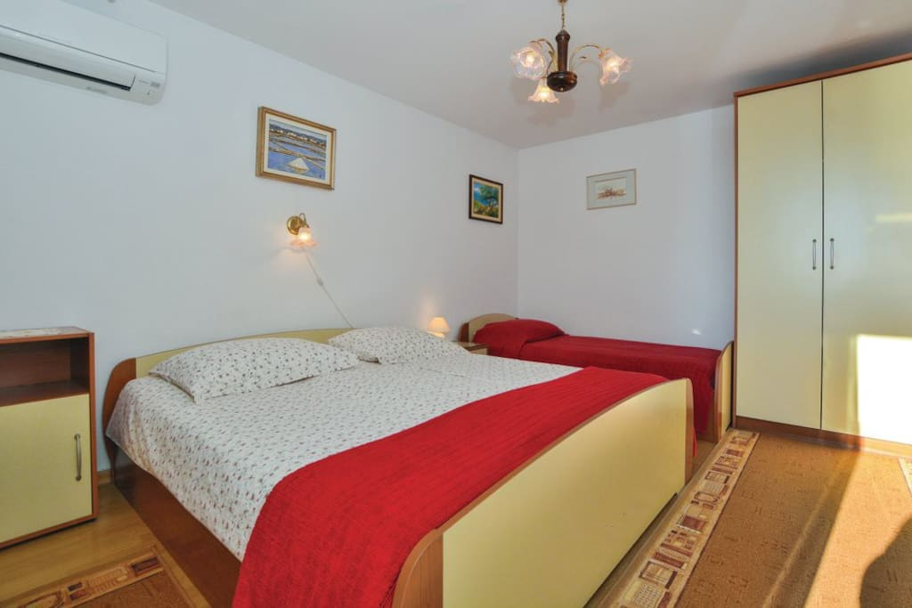 Bedroom with a double bed and single bed