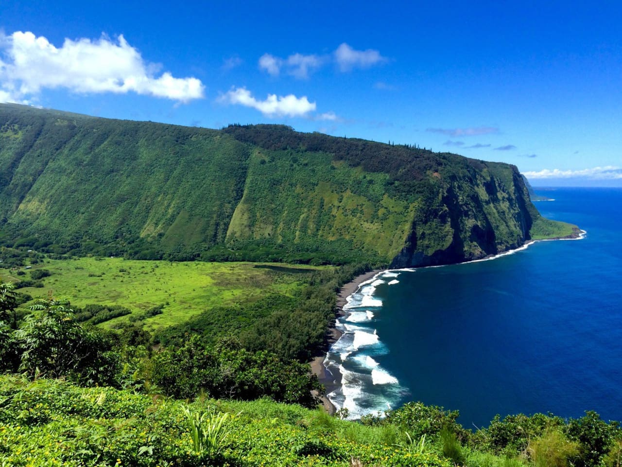 Waipio Valley! Just one of the many adventures that await you in Hawaii!