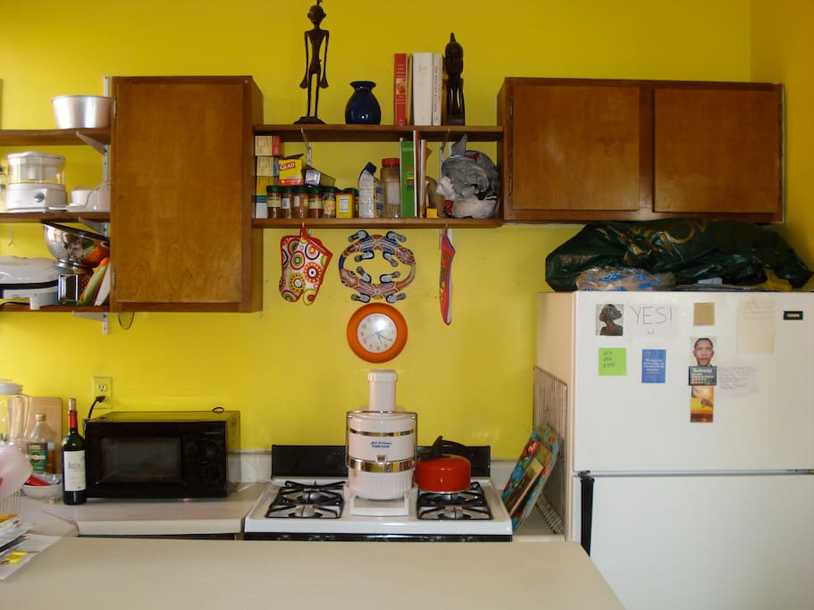 Kitchen: Microwave, stove, refrigerator, cabinets, sink, counter top, window. Next to living room.