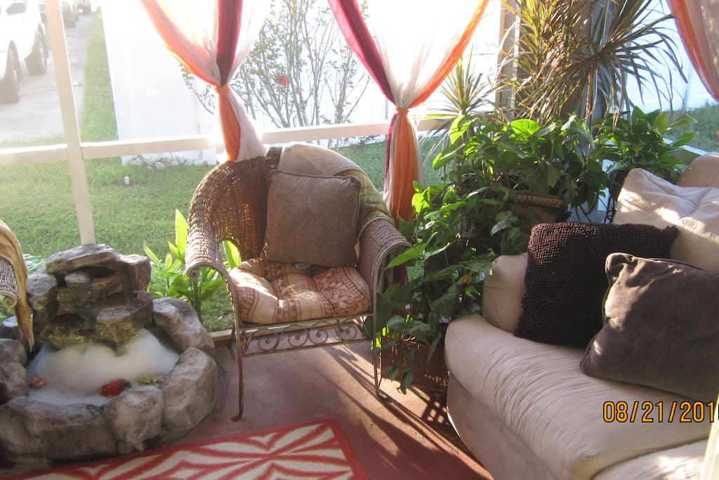 Peaceful back porch for lounging or having morning coffee