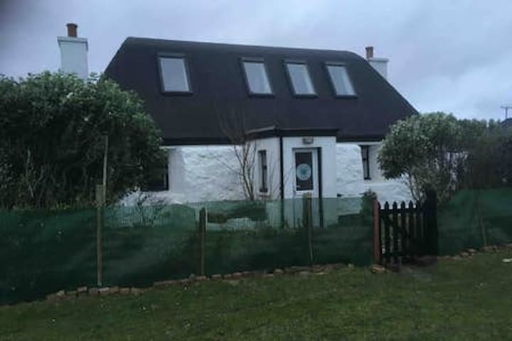 A Listed Traditional Black Roofed House, onTiree