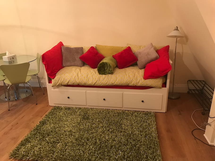 This lovely sofa bed,easily  Pulled out to turn it into a double bed.