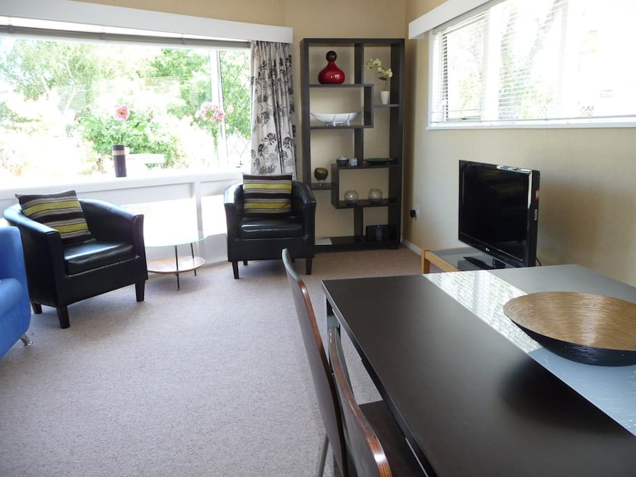 "Spacious open plan living area with dining table to seat 4, and 32"" LED TV with Freeview and DVD player"
