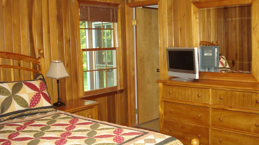 Solid wood furnishings and paneling in the master bedroom.  TV w/ satellite