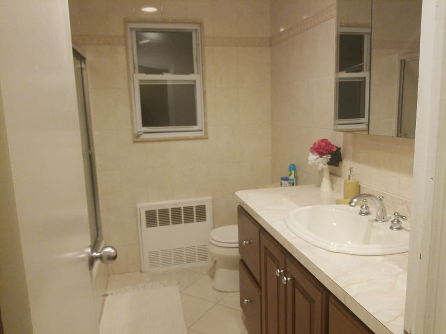 extremely clean bathroom, which is shared space.