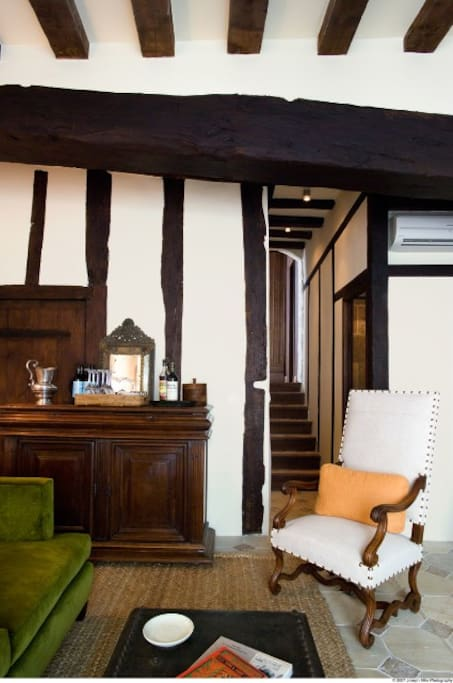 Master Salon with 15th-century wood beams, stone floors and vaulted passage stairway