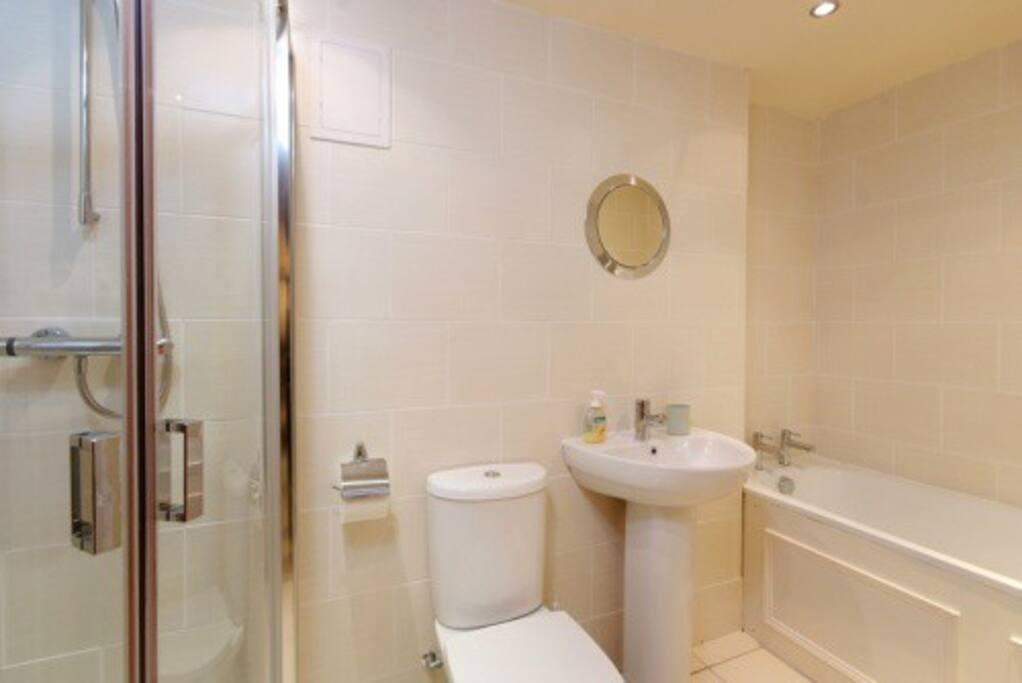 Family bathroom situated near bedroom one.  bath, w.c. wash hand basin & shower enclosure.