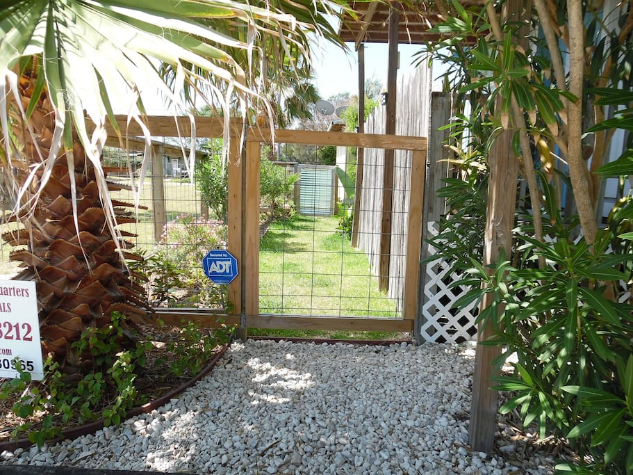 Side entrance to fenced yard and patio