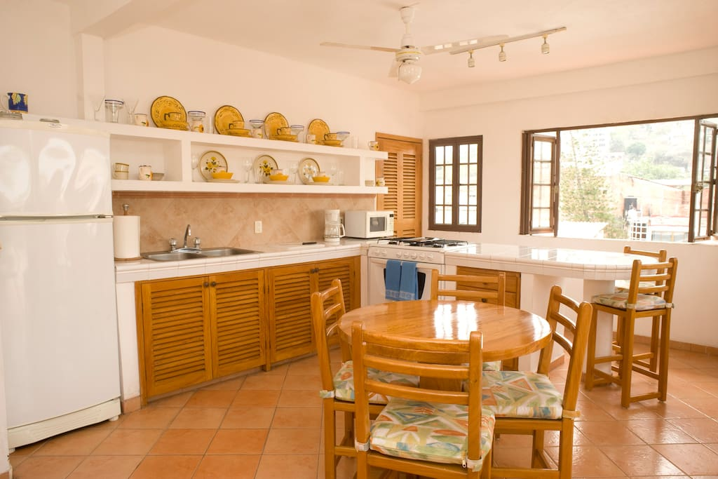 Large windows open to allow cross breezes and views to the hills of Puerto Vallarta