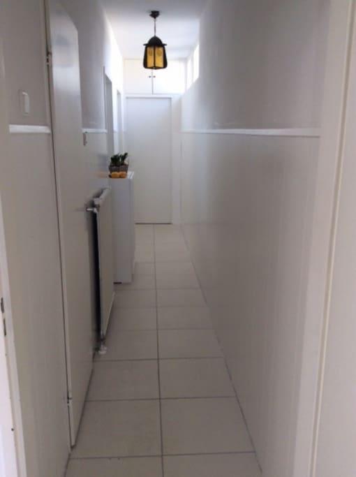 Hallway from the front door towards the room