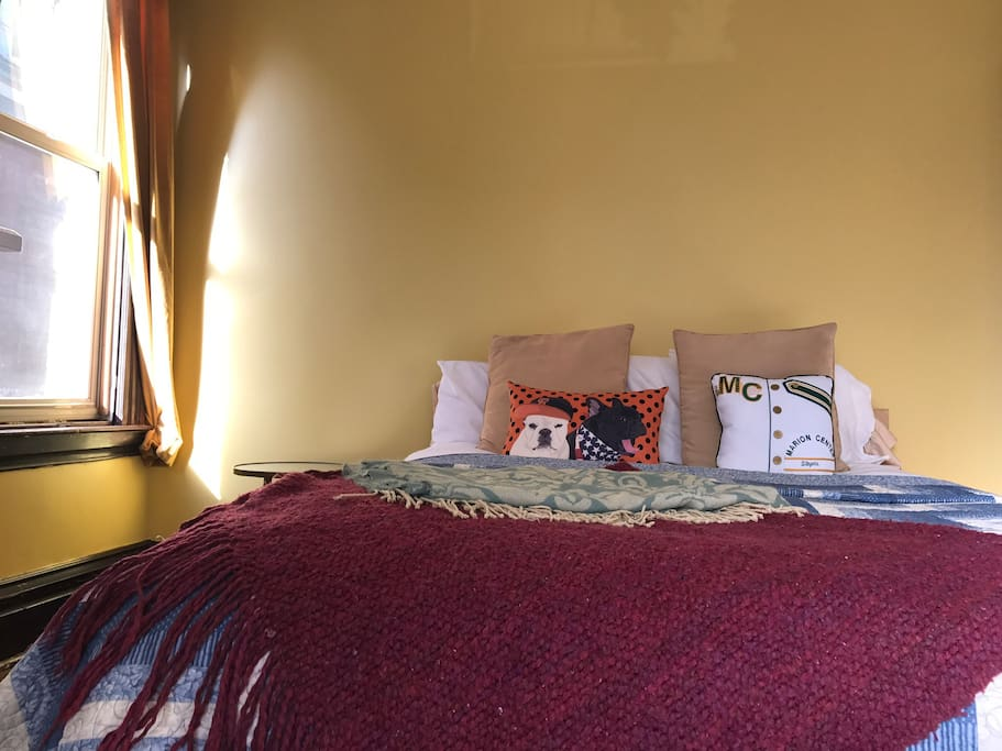 Our guest room is also the sunniest (three windows!) and largest room.
