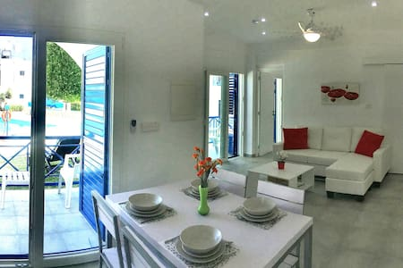 Stunning Pool view 2bed Apt. opposite the Beach