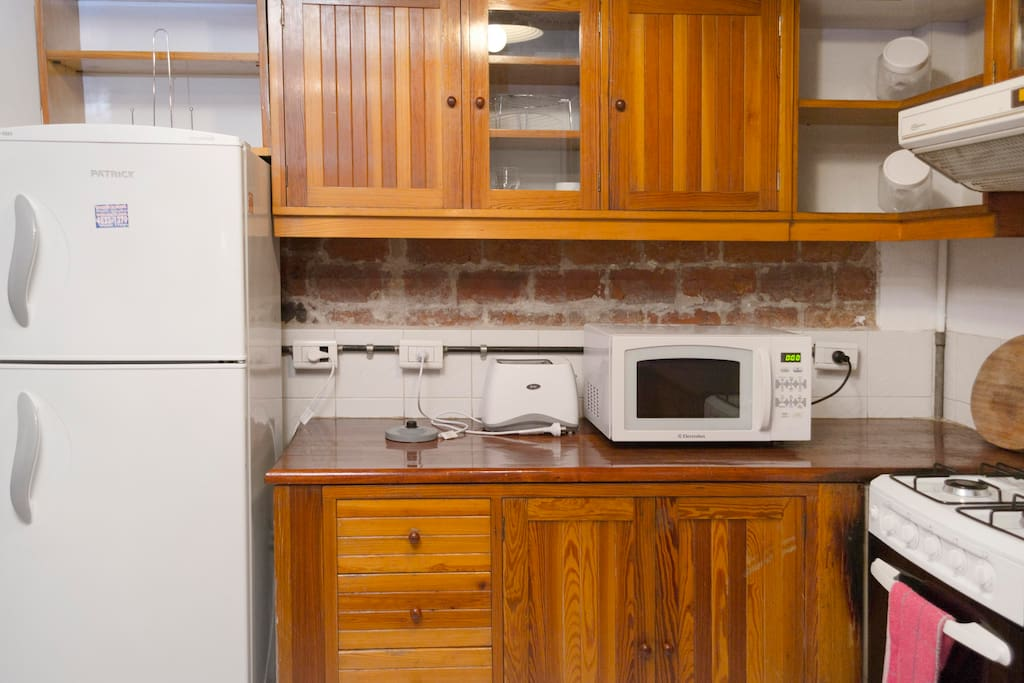 Kitchen with gas cooker, frige , double electric oven and microwave, kettle and toaster