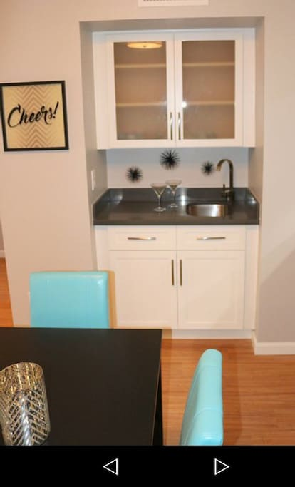 Wet Bar for entertaining along with automatic wine bottle opener