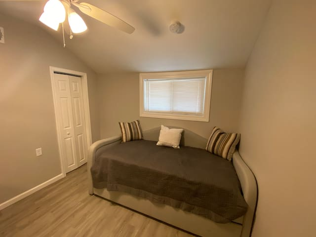 This bedroom is our smallest space but it has a great closet and large dresser to make up for it! The bed also has another twin mattress that pulls out to accommodate 2 comfortably in this room!