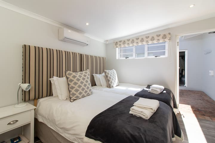 Bedroom 3 with two single beds pushed together