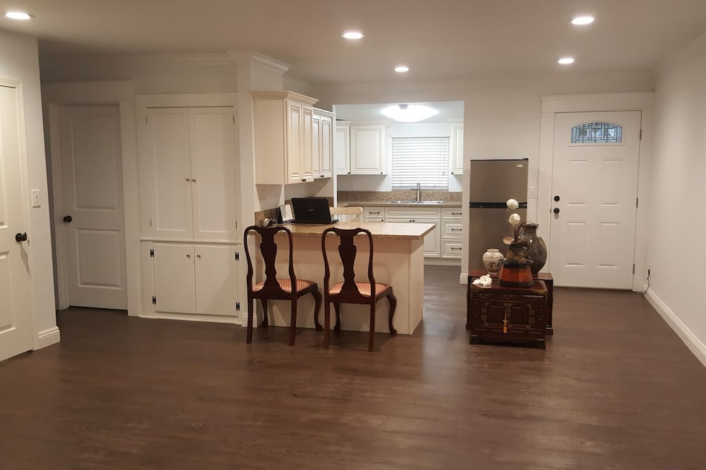View of kitchen & breakfast bar (note: chairs have been replaced with modern bar stools)