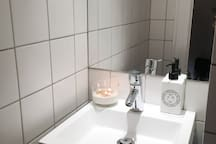 Bathroom sink with scented candle