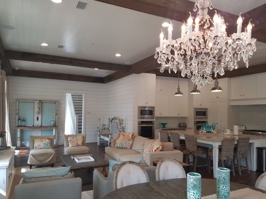 Sun-filled kitchen, living and dining areas with beautiful furnishings