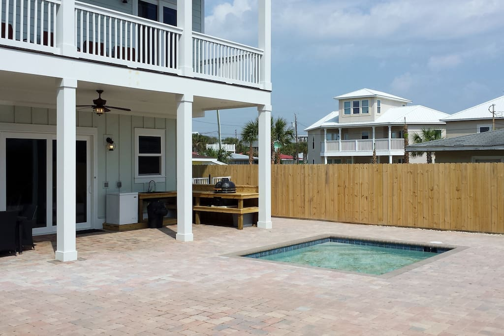 Grilling area in private back yard. Covered table seats 8, plus bar top and additional seating.
