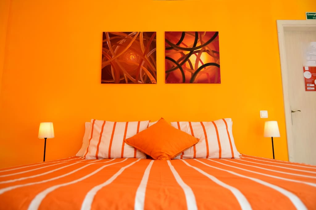 Double orange room with private bathroom, tea and coffee facilities
