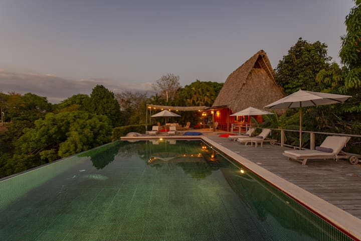 The expansive infinity pool at dusk, perfect for exercising or relaxing