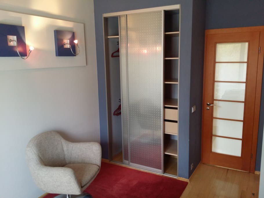 Double room wardrobe and sitting area
