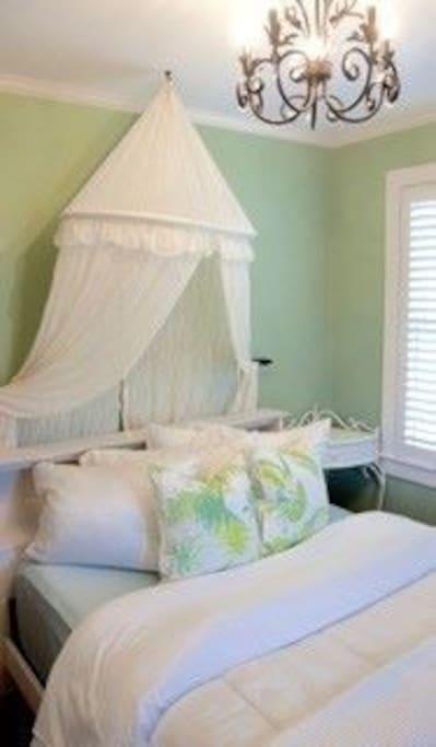 Bedroom 1 sleeps 1-2 with a queen bed.