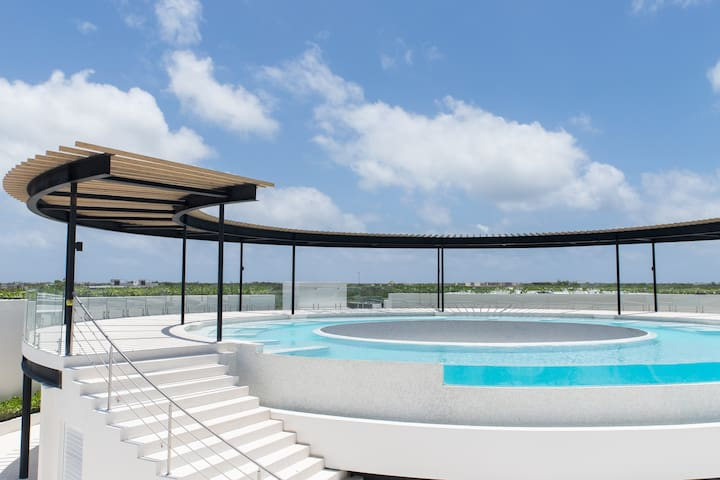 360º rooftop infinity pool with a 12 meter waterfall in the world.
